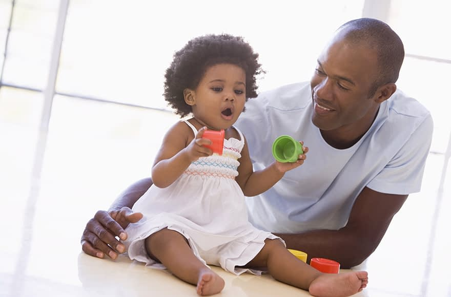Image of a Child Behavior Clinic Father Playing with His 0-12 Daughter